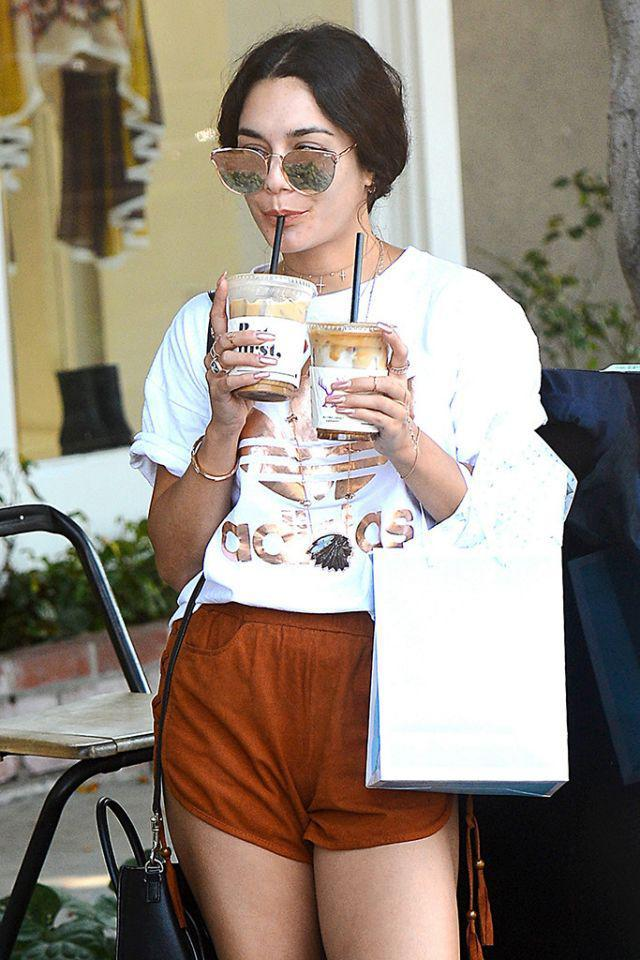 <p>Vanessa double-fisted a couple of iced coffees in La La Land. So <em>that's</em> her secret to staying so perky! (Photo: AKM-GSI) </p>