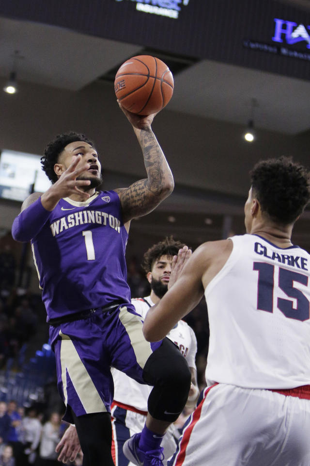Washington guard David Crisp (1) shoots in front of Gonzaga forward Brandon Clarke (15) during the first half of an NCAA college basketball game in Spokane, Wash., Wednesday, Dec. 5, 2018. (AP Photo/Young Kwak)