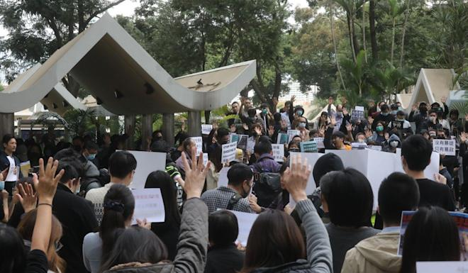 Protesters hold up signs and chant slogans during the rally in Central. Photo: K.Y. Cheng