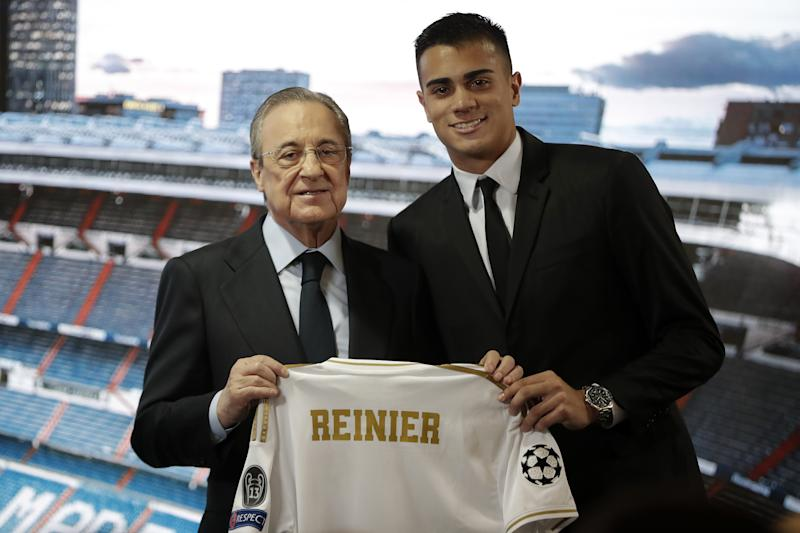 MADRID, SPAIN - FEBRUARY 18: President of Real Madrid Club Florentino Perez and Real Madrid's new signing 18-year-old Brazilian footballer Reinier Jesus Carvalho pose for a photo during a signing ceremony at Santiago Bernabeu Stadium in Madrid, Spain on February 18, 2020. (Photo by Burak Akbulut/Anadolu Agency via Getty Images)