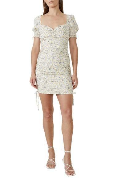 <p>The side ties of this <span>Bardot Ruched Floral Minidress</span> ($119) are flirty and cute.</p>