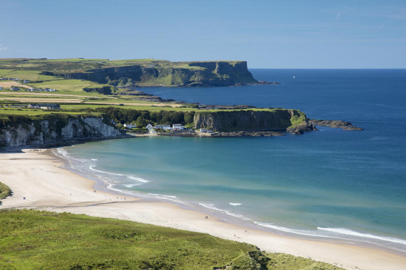 View across White Park Bay and Portbraddan, Causeway Coast, County Antrim, Northern Ireland [Photo: Getty]