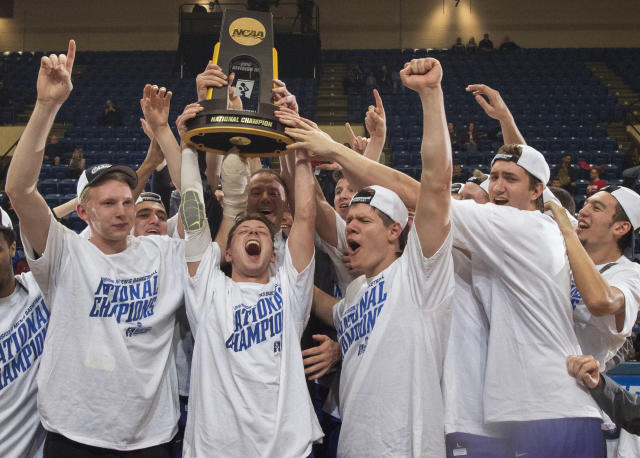 FILE - In this March 19, 2016, file photo, St. Thomas players, from left, Thomas Sjoberg, Grant Shaeffer, Will Dunn, Jodan Burich and G.T. Johnson celebrate after St. Thomas won NCAA Division III men's college basketball championship game 82-76 over Benedictine in Salem, Va. The NCAA has given the University of St. Thomas permission to move its sports teams directly from Division III to Division I. The Tommies were granted a waiver to bypass the current reclassification rules that require a stop first in Division II. (AP Photo/Don Petersen, File)