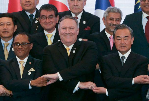 PHOTO: Secretary of State Mike Pompeo crosses his arms for the traditional 'ASEAN handshake' with Chinese Foreign Minister Wang Yi and other fellow diplomats during the 26th ASEAN Regional Forum in Bangkok, Thailand, Aug. 2, 2019. (Jonathan Ernst/Pool via Reuters)