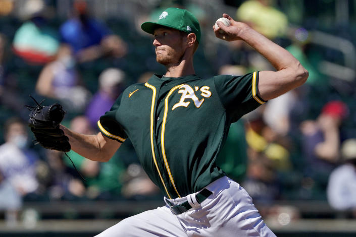 Oakland Athletics starting pitcher A.J. Puk throws against the Kansas City Royals during the first inning of a spring training baseball game, Wednesday, March 17, 2021, in Mesa, Ariz. (AP Photo/Matt York)