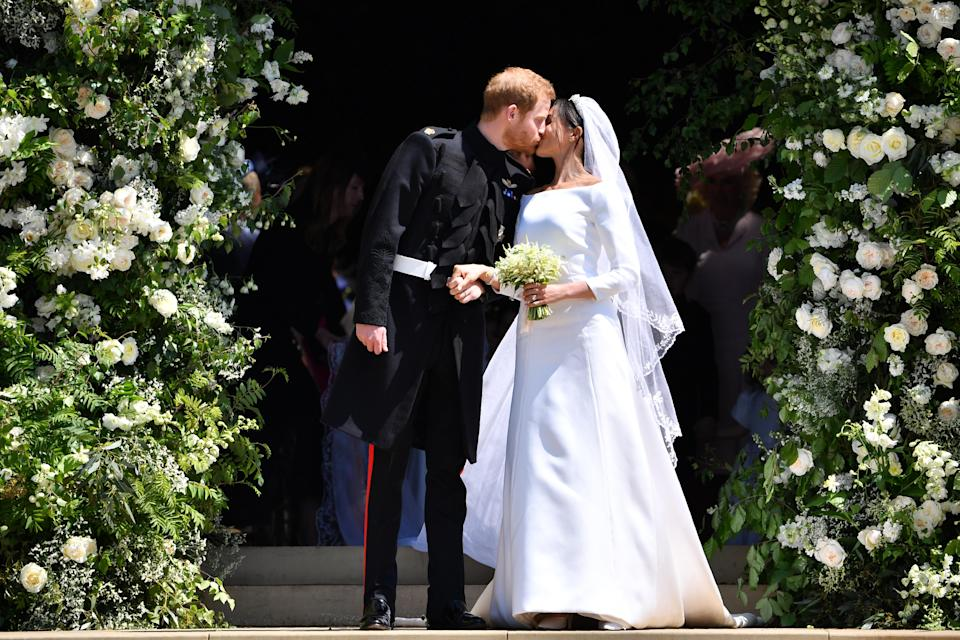 <p>Prince Harry and former actress Meghan Markle tied the knot at St George's Chapel at Windsor Castle on May 19 2018. The bride wowed in a pure white double-bonded silk cady wedding dress, designed by Clare Waight Keller of Givenchy [Photo: Getty] </p>