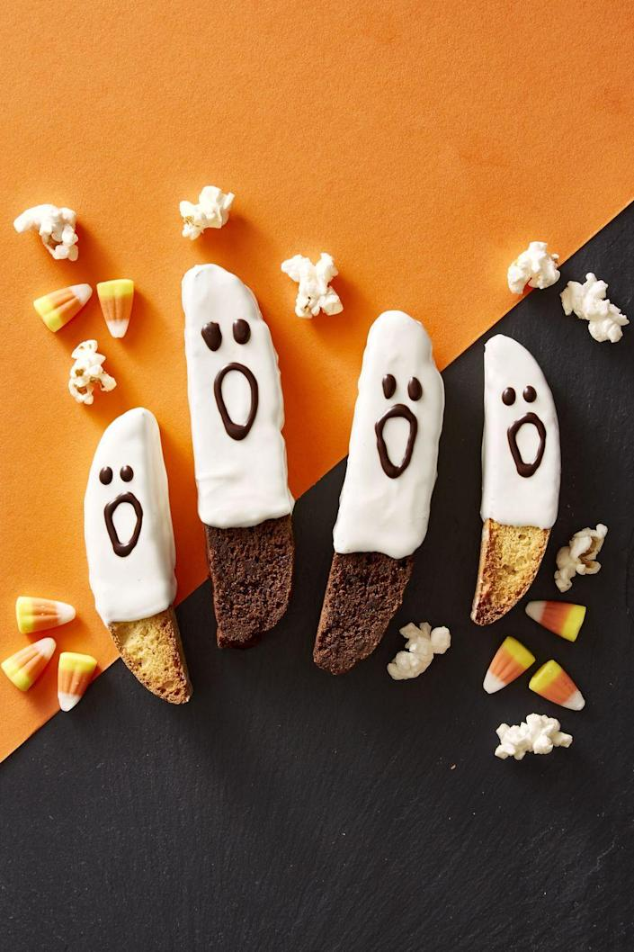 """<p>This recipe is as easy as dipping biscotti in white chocolate and drawing little faces on them with milk chocolate.</p><p><strong><em>Get the recipe at <a href=""""https://www.goodhousekeeping.com/food-recipes/a46101/boo-scotti-recipe/"""" rel=""""nofollow noopener"""" target=""""_blank"""" data-ylk=""""slk:Good Housekeeping"""" class=""""link rapid-noclick-resp"""">Good Housekeeping</a>.</em></strong></p>"""