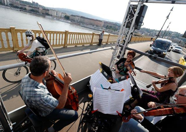 An orchestra plays on a truck