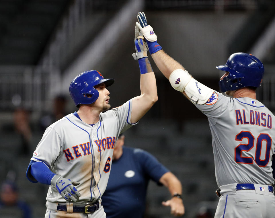 New York Mets' Jeff McNeil (6) gets a high five from Pete Alonso (20) after hitting a home run in the ninth inning of a baseball game Tuesday, June 18, 2019, in Atlanta. New York won 10-2. (AP Photo/John Bazemore)