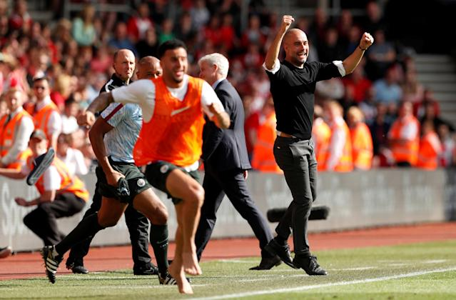 "Soccer Football - Premier League - Southampton vs Manchester City - St Mary's Stadium, Southampton, Britain - May 13, 2018 Manchester City manager Pep Guardiola celebrates their first goal scored by Gabriel Jesus Action Images via Reuters/John Sibley EDITORIAL USE ONLY. No use with unauthorized audio, video, data, fixture lists, club/league logos or ""live"" services. Online in-match use limited to 75 images, no video emulation. No use in betting, games or single club/league/player publications. Please contact your account representative for further details. TPX IMAGES OF THE DAY"