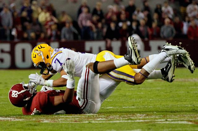 TUSCALOOSA, AL - NOVEMBER 05: Tyrann Mathieu #7 of the LSU Tigers tackles Michael Williams #89 of the Alabama Crimson Tide during the game at Bryant-Denny Stadium on November 5, 2011 in Tuscaloosa, Alabama. (Photo by Kevin C. Cox/Getty Images)