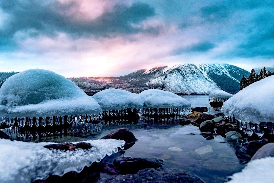 <p>Lake McDonald's waterfalls in Glacier National Park are normally flowing quickly, but in the winter, everything seems to hit the pause button. Here, you can see the frozen falls during a particularly cold day. </p>