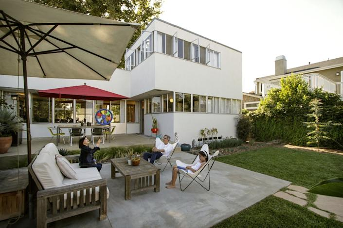 "Umbrellas provide shade outside a home designed by Raphael Soriano. <span class=""copyright"">(Ricardo DeAratanha / Los Angeles Times)</span>"