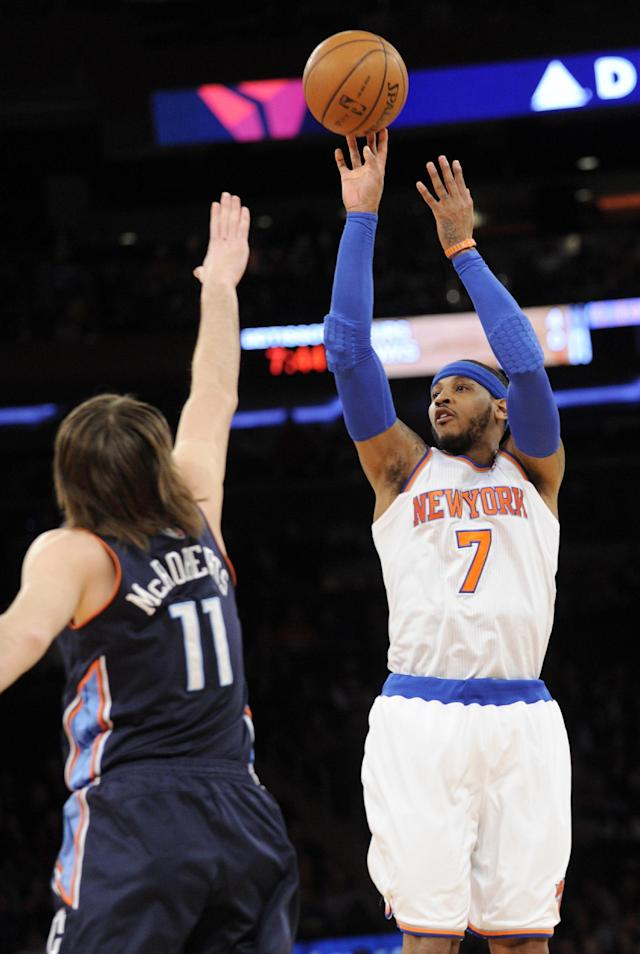 New York Knicks' Carmelo Anthony, right, shoots over Charlotte Bobcats' Josh McRoberts during the first quarter of an NBA basketball game, Friday, Jan. 24, 2014, at Madison Square Garden in New York. (AP Photo/Bill Kostroun)