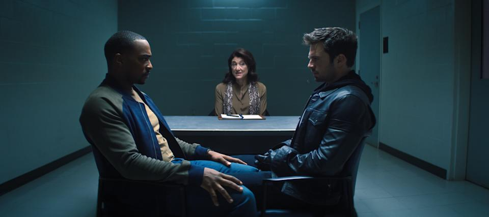 (L-R): Falcon/Sam Wilson (Anthony Mackie), therapist (Amy Aquino) and Winter Soldier/Bucky Barnes (Sebastian Stan) in Marvel Studios' THE FALCON AND THE WINTER SOLDIER exclusively on Disney+. Photo courtesy of Marvel Studios. ©Marvel Studios 2021. All Rights Reserved.