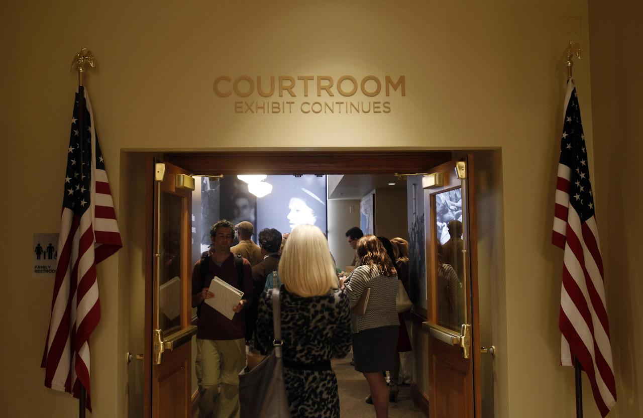 Members of the media enter an original courtroom in the building that houses the The Mob Museum on Monday, Feb. 13, 2012, in Las Vegas. The courtroom was once the site of mob trials. (AP Photo/Isaac Brekken)