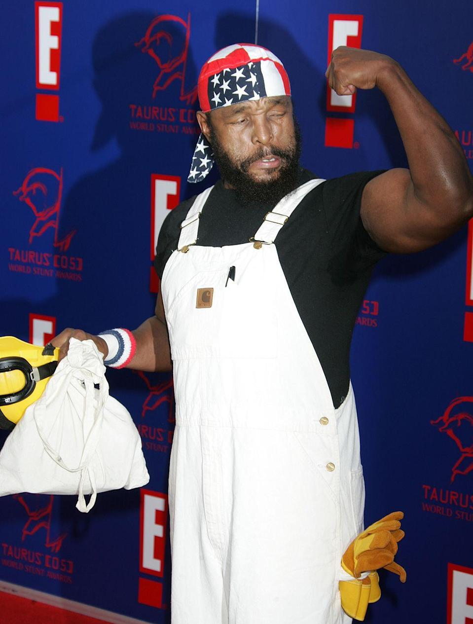 <p>Mr. T shows off his muscles at a red carpet event in 2005. We pity the fool who tries to compete with the former <em>The</em> <em>A-Team </em>star. </p>