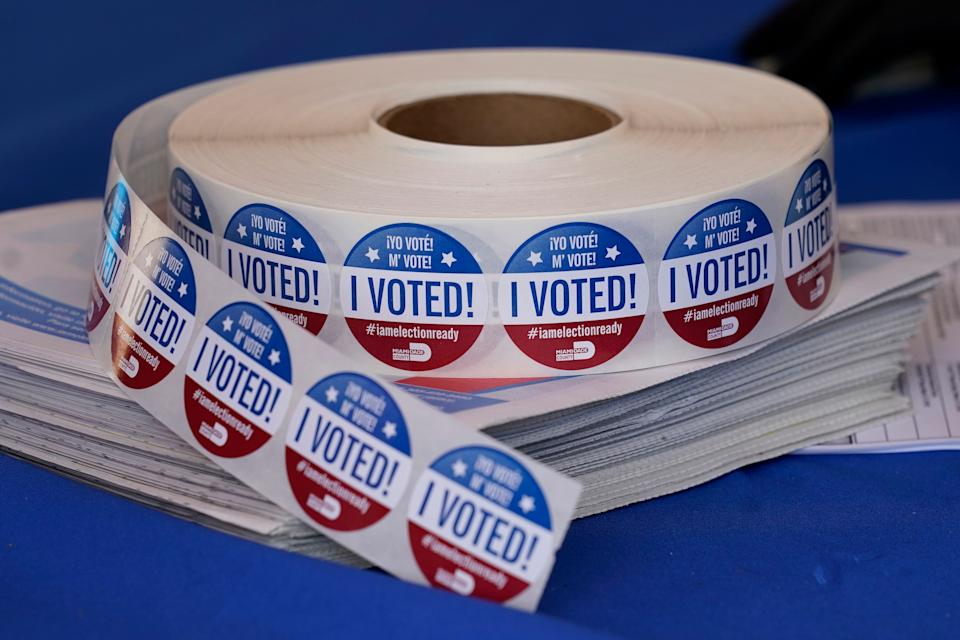 You can't just vote anywhere, but some states let people vote in person beyond one local polling location. (Photo: AP Photo/Lynne Sladky)