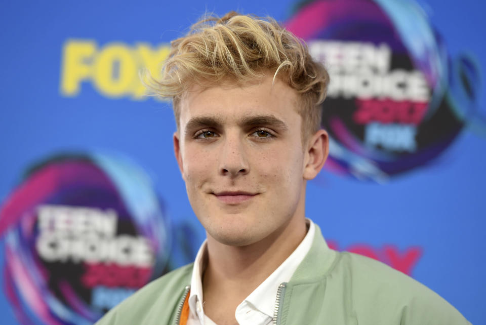 FILE - Internet personality Jake Paul arrives at the Teen Choice Awards in Los Angeles on Aug. 13, 2017. FBI agents including a SWAT team have raided the apparent home of YouTube star Jake Paul. FBI spokeswoman Laura Eimiller says agents executed a search warrant Wednesday at the Calabasas, California mansion in connection with an ongoing investigation. She could not say what the probe is about or who the target was. Helicopter video from local TV news showed agents gathering guns from the home that can frequently be seen on Paul's YouTube channel, which has over 20 million followers. (Photo by Jordan Strauss/Invision/AP, File)