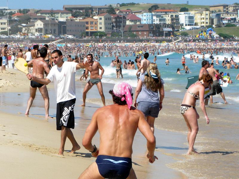 FILE - In this Jan. 6, 2009 file photo, people play on the shoreline of Bondi Beach in Sydney. If worry about skin cancer doesn't make you slop on sunscreen, maybe vanity will: New research provides some of the strongest evidence to date that near-daily sunscreen use can slow the aging of your skin. The new study, from Australia's Sunshine Coast, used a unique step to measure whether sunscreens really help that constant onslaught. Researchers compared fine lines on the hands of hundreds of people who, for more than four years, had been assigned to rub on sunscreen daily or only when they deemed it necessary. (AP Photo/Rob Griffith, File)