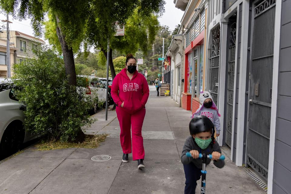 Lily Marquez, a married mother of two, on a walk with her family in San Francisco, Calif. on June 25, 2021.