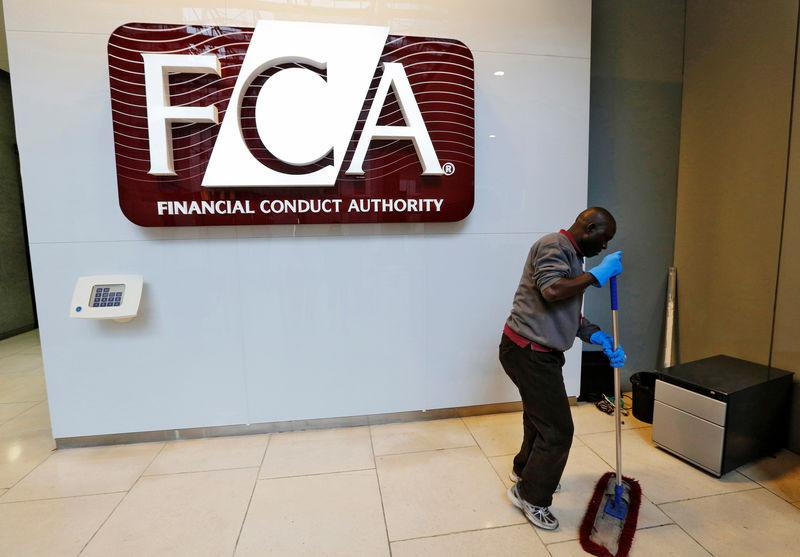 FILE PHOTO: A maintenance worker cleans the entrance area of the headquarters of the new Financial Conduct Authority (FCA) in the Canary Wharf business district of London April 1, 2013. REUTERS/Chris Helgren
