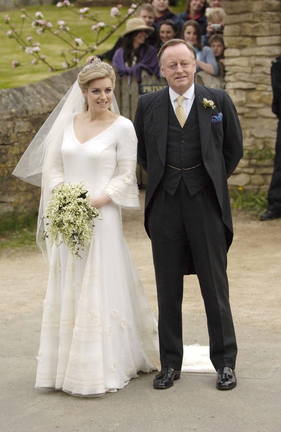 <p>Parker Bowles chose a v-neck gown with bell sleeves and floral details for her wedding to Harry Lopes.</p>