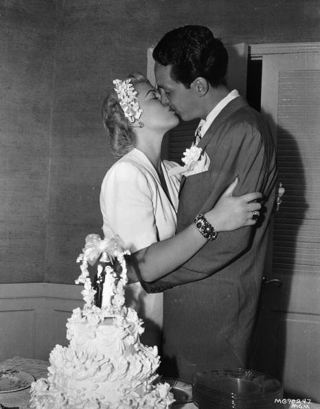 <p>Lana Turner seals her matrimony to second husband, Steve Crane, with a kiss in front of their wedding cake—although the couple would eventually divorce, marry, and divorce again. They welcomed their daughter, Cheryl Crane, in 1943. </p>