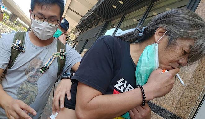 Leung Kwok-hung (right) was attacked outside the Chinese Liaison Office in Sai Wan.