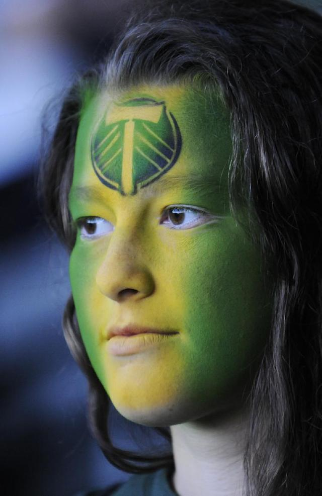 Portland Timbers' fan Kai Davidson watches the play against Seattle at the beginning of an MLS Soccer game in Portland, Ore., Sunday Oct. 13, 2013. Portland beat Seattle 1-0. (AP Photo/Greg Wahl-Stephens)