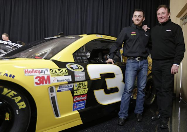 Austin Dillon, left, and team owner Richard Childress, right, pose by one of the cars Dillon will drive in the 2014 NASCAR Sprint Cup series during a news conference at Charlotte Motor Speedway in Concord, N.C., Wednesday, Dec. 11, 2013. The late Dale Earnhardt's famed No. 3 will be back on track in the elite Sprint Cup Series next season with Dillon using the number. (AP Photo/Chuck Burton)