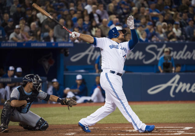 Toronto Blue Jays first baseman Rowdy Tellez watches his two-run home run next to Tampa Bay Rays catcher Nick Ciuffo during the second inning of a baseball game in Toronto on Thursday, Sept. 20, 2018. (Nathan Denette/The Canadian Press via AP)
