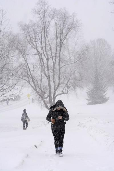 Williams College students trek across the snowy campus in Williamstown, Mass., during a winter storm which brought blizzard conditions and heavy snow to the region. Sunday, Feb. 12, 2017. (Gillian Jones/The Berkshire Eagle via AP)