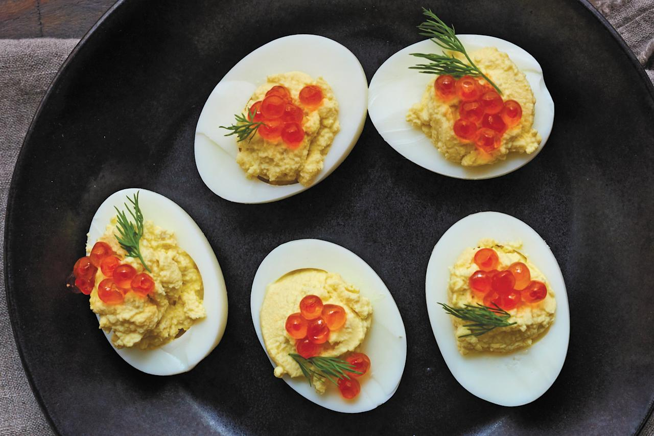 "A topping of salmon roe gives these deviled eggs an extra layer of flavor. <a href=""https://www.epicurious.com/recipes/food/views/russian-deviled-eggs-with-salmon-roe-caviar?mbid=synd_yahoo_rss"">See recipe.</a>"