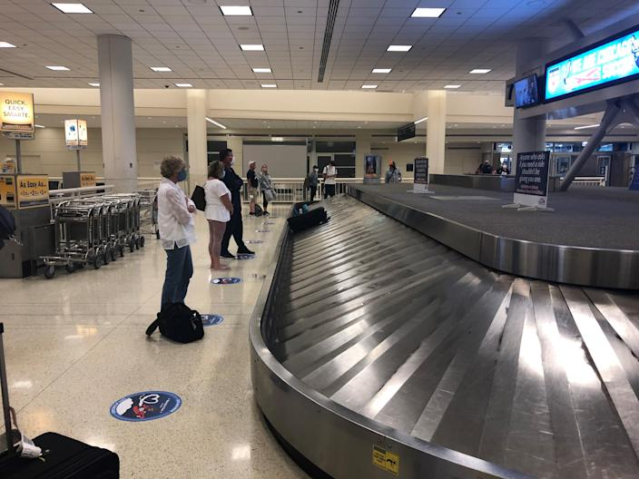The Southwest Airlines baggage carousel at Midway International Airport in Chicago has social distancing markers on the floor for passengers to stand on as they wait for their bags.
