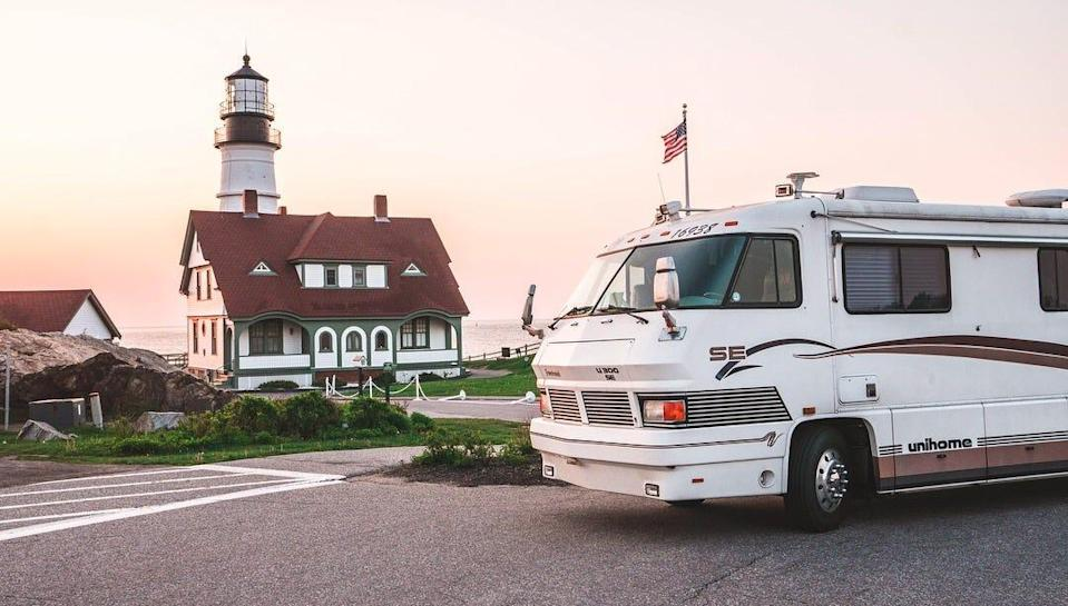 the exterior of the walker family RV in front of a lighthouse