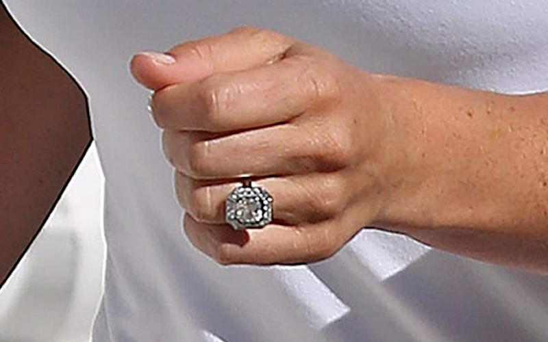 Pippa Middleton shows off her art-deco style engagement ring. - Credit: PA