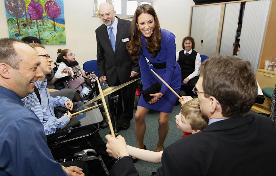 Kate meets with children at the EACH Treehouse hospice in Ipswich, in 2012 (PA)
