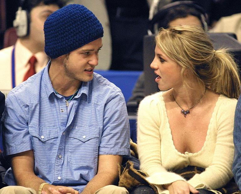 Britney Spears (R) and then-boyfriend Justin Timberlake (L) at the NBA All-Star Game in February 2002
