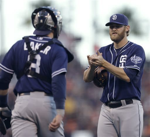 San Diego Padres' Andrew Cashner, right, meets with catcher John Baker (8) in the fourth inning of a baseball game against the San Francisco Giants Saturday, April 20, 2013, in San Francisco. (AP Photo/Ben Margot)