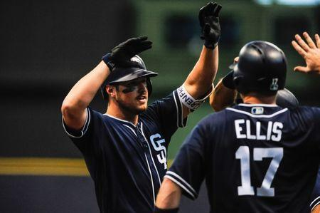 Aug 9, 2018; Milwaukee, WI, USA; San Diego Padres left fielder Hunter Renfroe (10) reacts with catcher A.J. Ellis (17) and teammates after hitting a grand slam home run during the ninth inning against the Milwaukee Brewers at Miller Park. Mandatory Credit: Jeffrey Becker-USA TODAY Sports