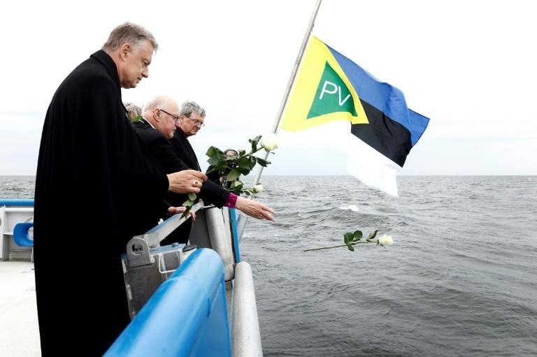 Bishops throw white rose into the sea at the start of a new inquiry into the 1994 sinking of the ferry MS Estonia and loss of 852 lives