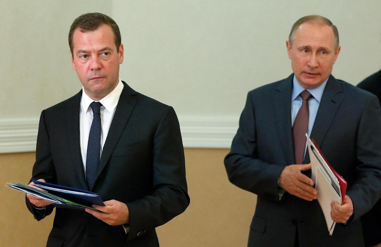 "Russian Prime Minister Dmitry Medvedev (L) and Russian President Vladimir Putin (R) attend a meeting with permanent members of the Security Council of the Russian Federation at the Belbek airport near the Black sea port of Sevastopol, Crimea, on August 19, 2016.Putin's visit comes after he lashed out last week at Kiev over an incident on the frontier between Crimea and Ukraine, accusing it of ""practising terror"" and sending a group of saboteurs into Crimea ahead of the elections. (AFP Photo/Dmitry Astakhov)"