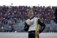 Josef Newgarden (2) looks up during the national anthem before the start an IndyCar auto race at World Wide Technology Raceway on Saturday, Aug. 21, 2021, in Madison, Ill. (AP Photo/Jeff Roberson)