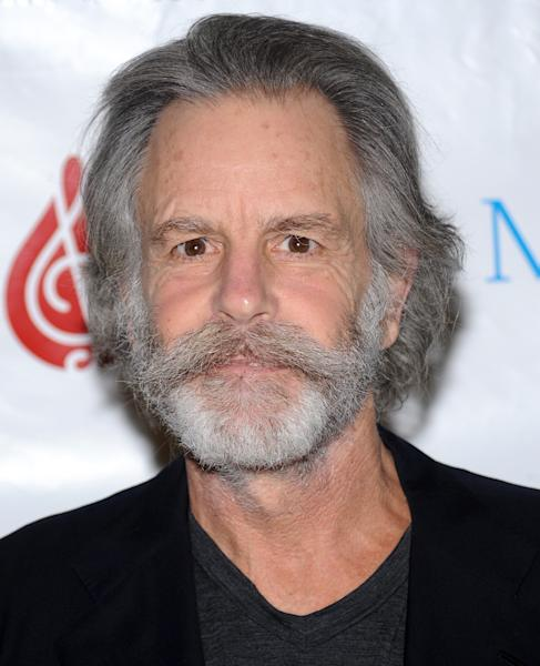 FILE - This Feb. 24, 2010 file photo shows musician Bob Weir at SIRIUS XM Radio in New York. Weir fell onstage while strumming his guitar at a concert in Port Chester, N.Y. In a video posted online, the 65-year-old musician collapsed Thursday during a performance with his Furthur bandmates at The Capitol Theatre. He was quickly helped off the floor as the crowd cheered him on. Weir is currently on a tour with Furthur, the band he formed with fellow Grateful Dead bandmate Phil Lesh. Lesh told the crowd Thursday that Weir had been suffering from a strained shoulder. (AP Photo/Evan Agostini, file)