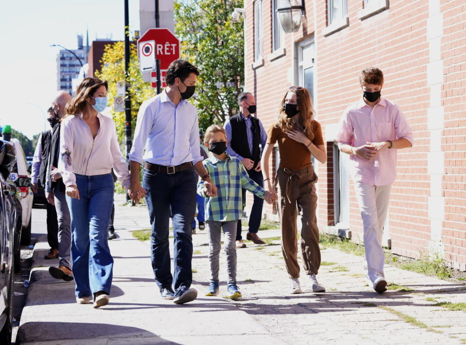 Liberal leader Justin Trudeau arrives to cast his ballot in the 44th general federal election as he's joined by wife Sophie Gregoire-Trudeau, and children, Xavier, Ella-Grace and Hadrien in Montreal on Monday, Sept. 20, 2021. (Paul Chiasson/The Canadian Press via AP)
