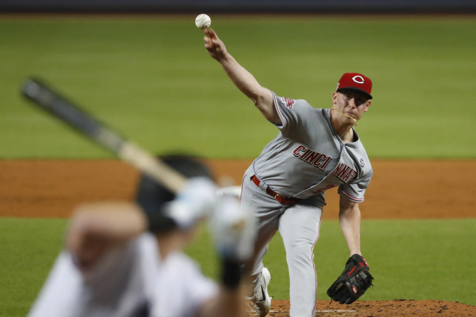 Cincinnati Reds' Anthony DeSclafani pitches to Miami Marlins' Garrett Cooper during the first inning of a baseball game, Wednesday, Aug. 28, 2019, in Miami. (AP Photo/Wilfredo Lee)