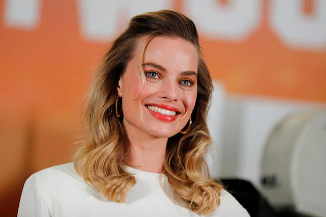 """Cast member Margot Robbie poses for a picture as she takes part in a photo call for the movie """"Once Upon a Time in Hollywood"""" in Beverly Hills, California, U.S. July 11, 2019. REUTERS/Mike Blake"""