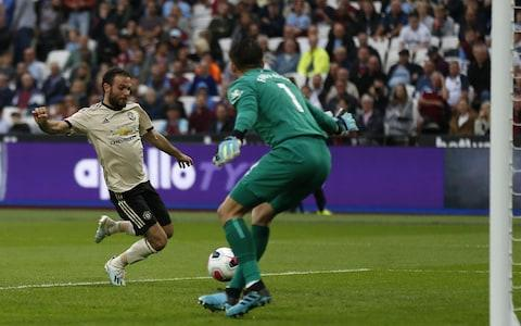 Manchester United's Spanish midfielder Juan Mata (L) misses a chance at goal during the English Premier League football match between West Ham United and Manchester United at The London Stadium, in east London on September 22, 2019 - Credit: Getty Images
