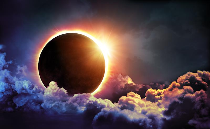 A solar eclipse among clouds.